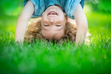 Child standing upside down
