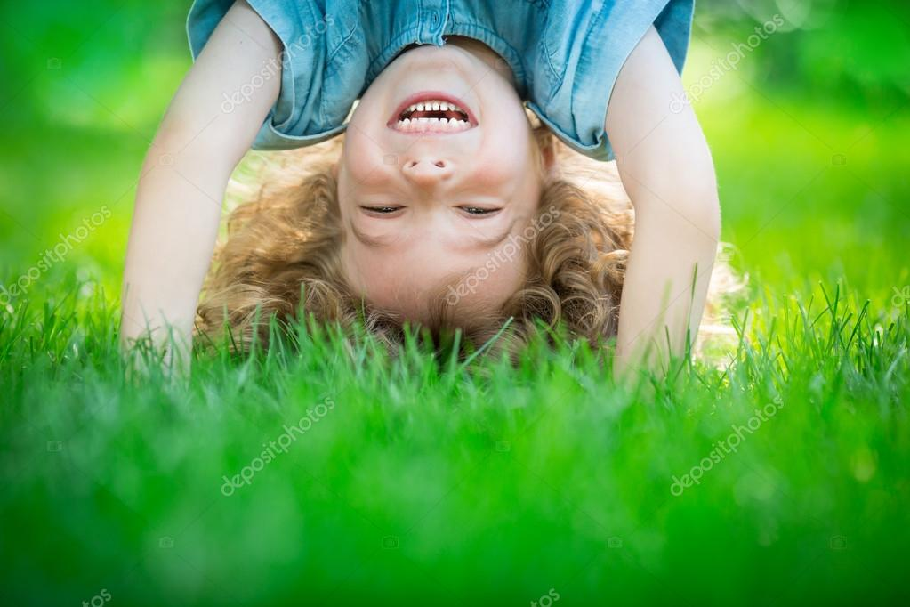Child standing upside down