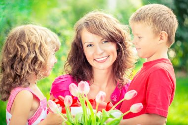 Family with bouquet of flowers