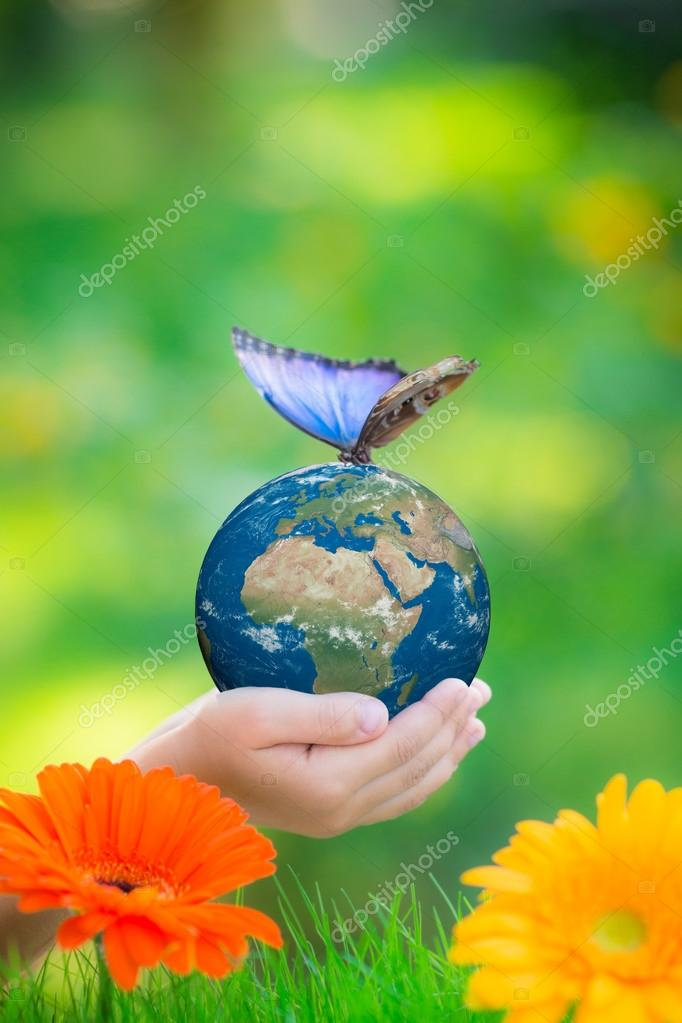 Child holding Earth planet