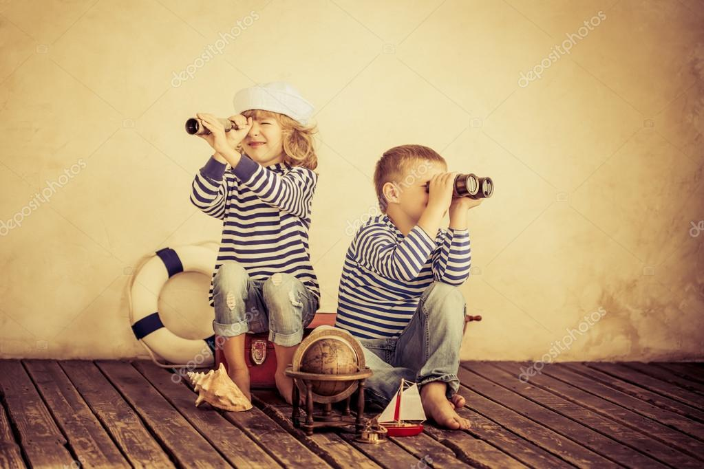 Children playing with vintage nautical things