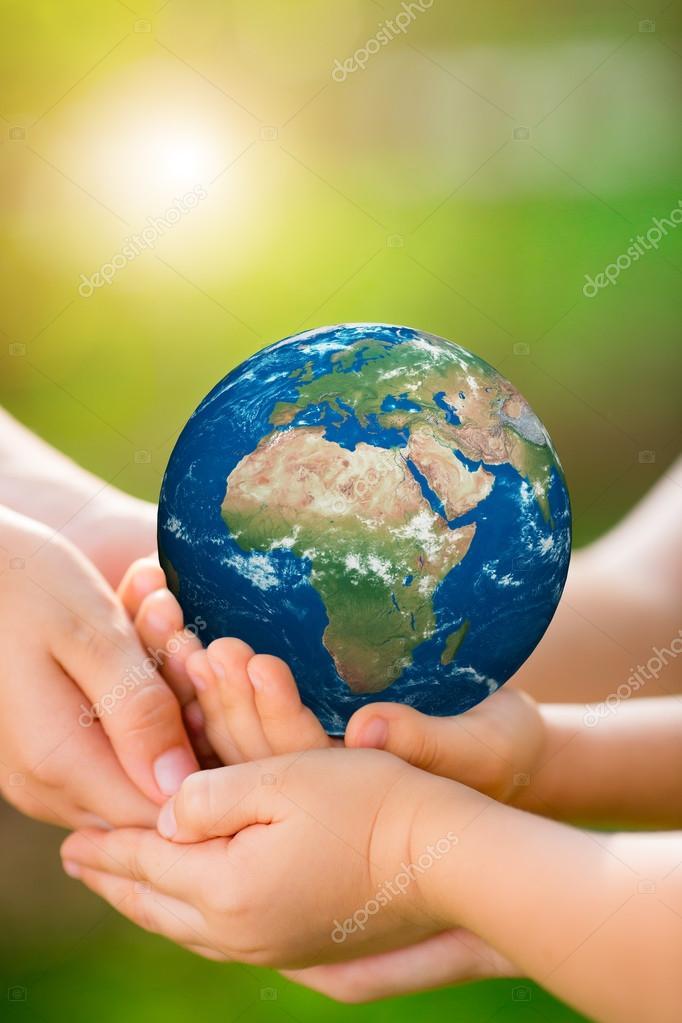 Children holding Earth planet