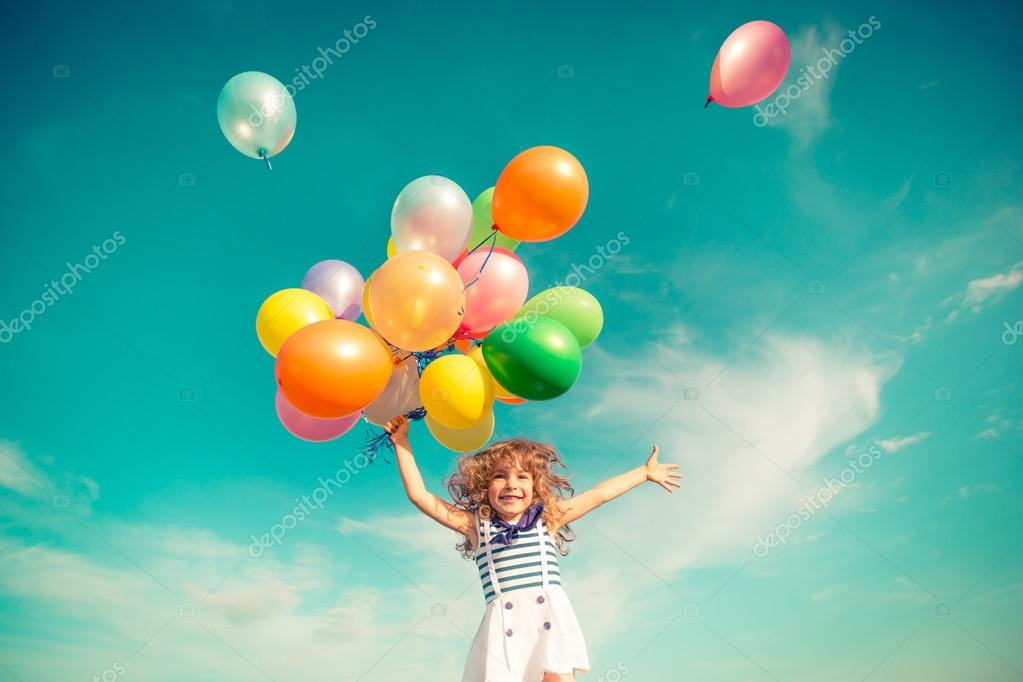 Child jumping with toy balloons