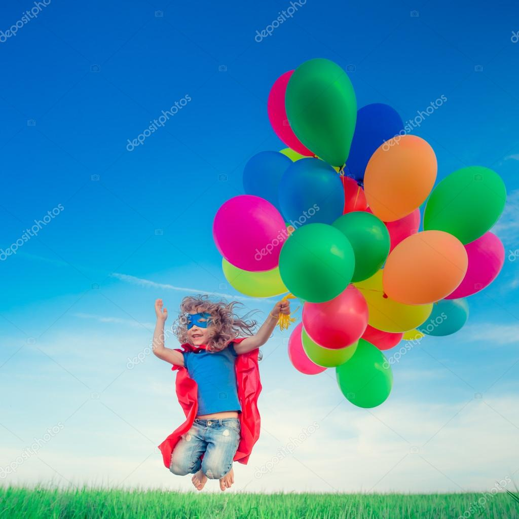 Superhero with toy balloons