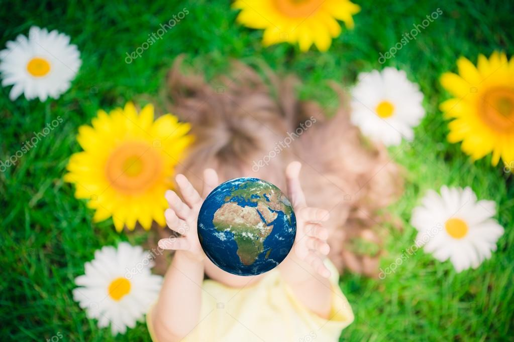 Child holding Earth planet in hands