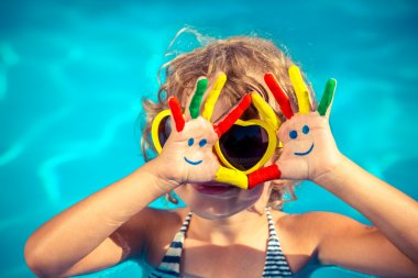 Funny child with drawing smiley on hands in swimming pool. Summer vacation concept stock vector