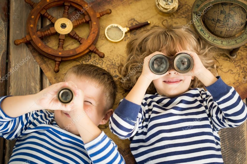 Happy kids playing with nautical things