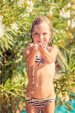 Happy child taking shower