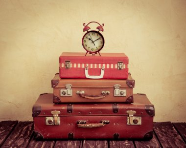 clock on  classic  leather suitcases.