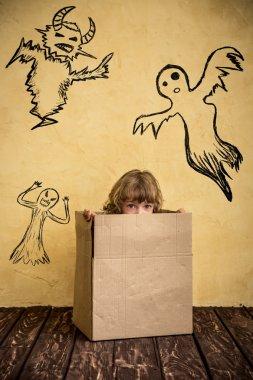 child dressed witch costume