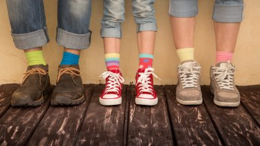 family legs in shoes with different socks
