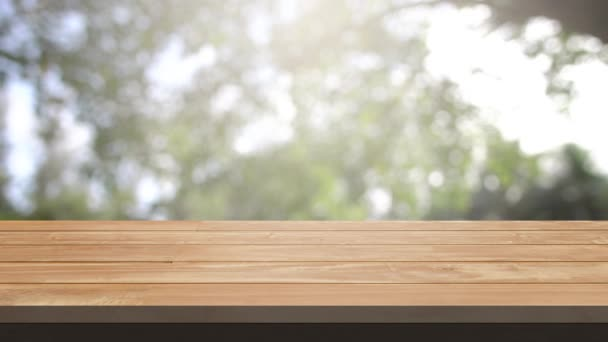 Table and Chair, Wood table bar and nature tree bokeh blurred background at morning time and beautiful nature sun light, Top wood table space area for products shows. 3840x2160. 4K UHD. Video Clip.