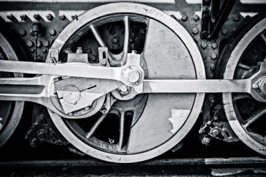 Closeup view of steam locomotive wheels, drives, rods, links and