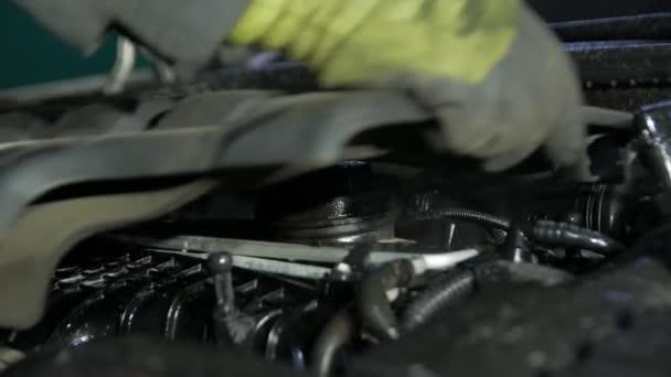 Mechanic Servicing The Engine