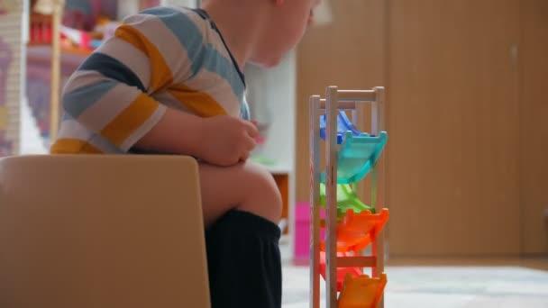 Child Sitting On A Potty