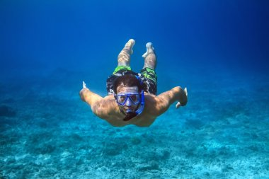 young man snorkeling