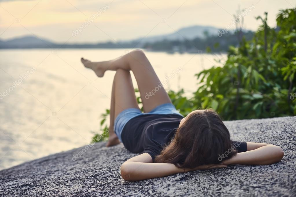 Young woman relax on cliff