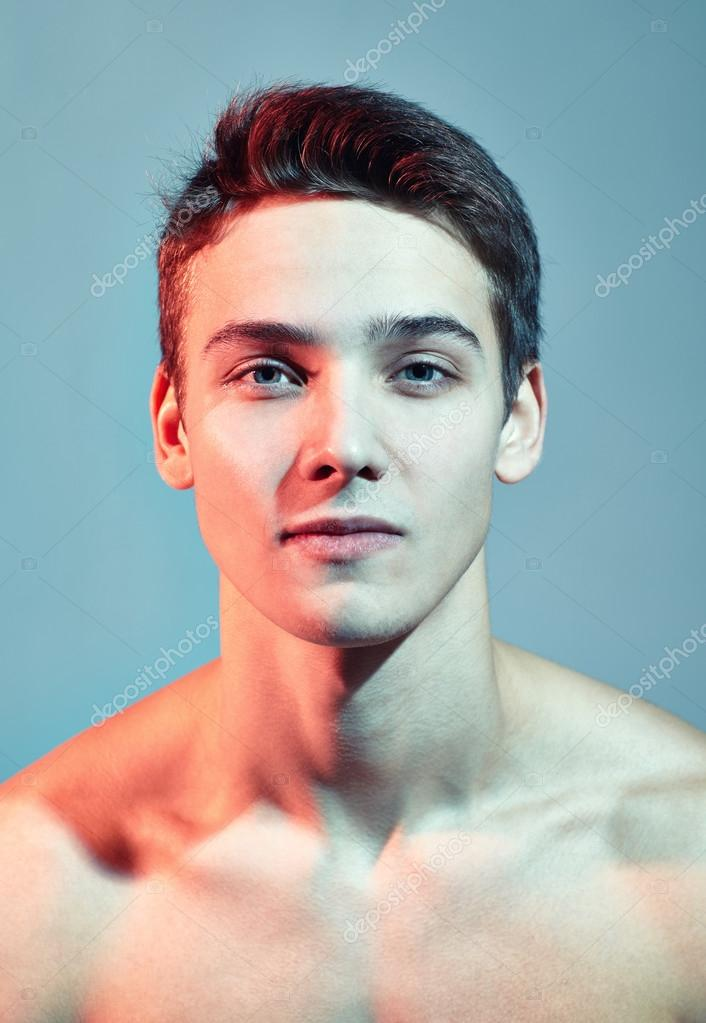 young handsome man face stock photo gladkov 52879269