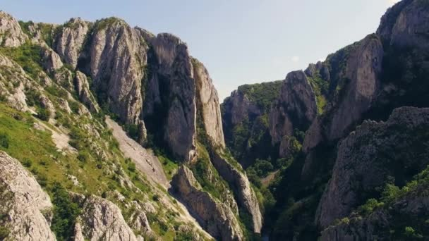 Stunning aerial view of mountainous region with cliffs and green grass