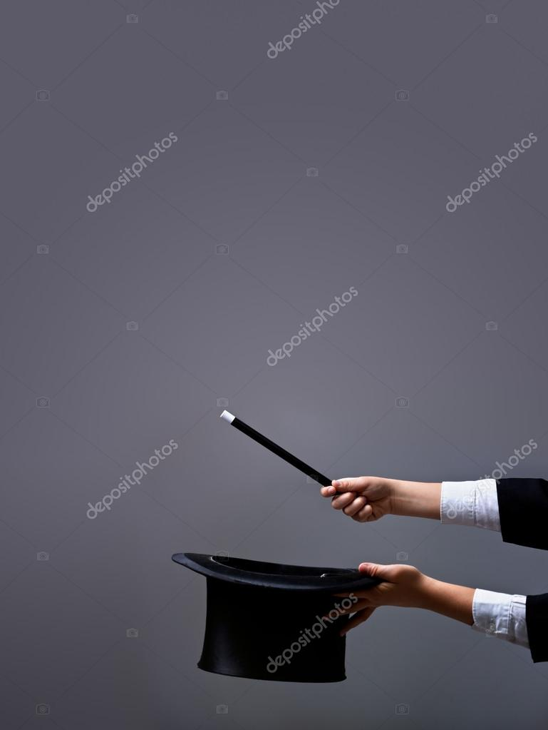Magician hands with hat and wand