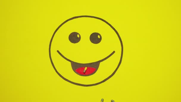 Painted Smiley On Yellow Background. Pills Move Into The Smileys Mouth.