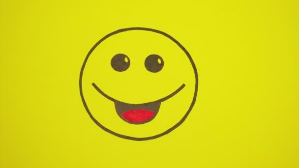 Malovaný úsměv na žlutém pozadí. Prášky přesunout do Smajlík ústa.