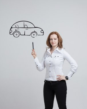 Woman drawing car, concept on the subject of dreams or financial planning