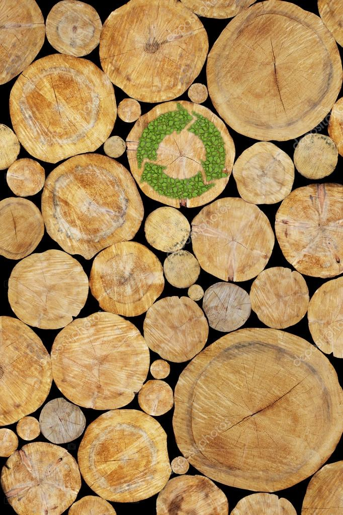 Stacked Logs Background with green plant recycle symbol