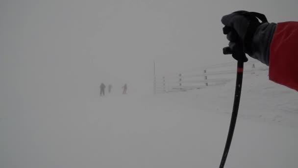 skiing. ski resort. winter vacation, weekends holidays, snow-capped mountains in fog. subjective dynamic camera. unrecognizable people. Slovakia Jasna. FullHD footage.