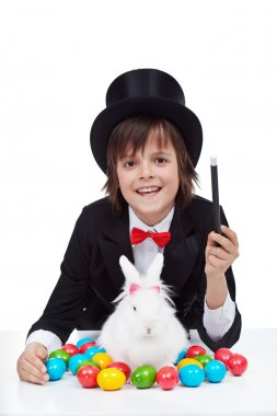 Young magician boy preparing for easter