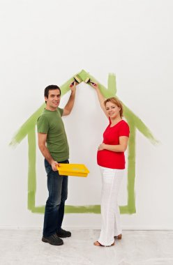 Young couple expecting a baby - preparing the child room