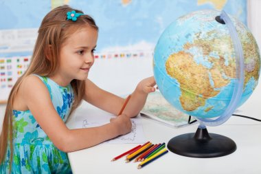 Young girl in geography class learning about our planet stock vector