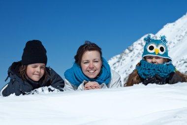 Happy family in the snow - portrait