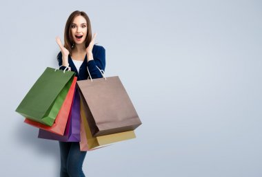 woman in casual clothing with shopping bags, with copyspace