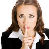 Porträt des jungen schwere geschäftsfrau Finger auf ihre Lippen halten und Fragen ruhig zu bleiben, isoliert