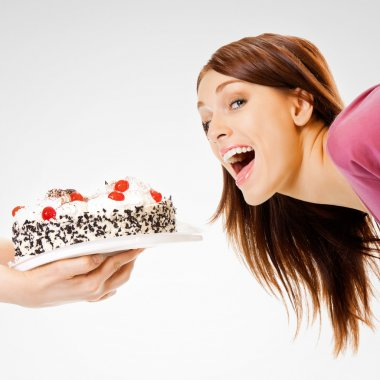 Young woman eating pie