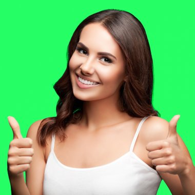 Woman showing thumbs up gesture, on green chroma key background
