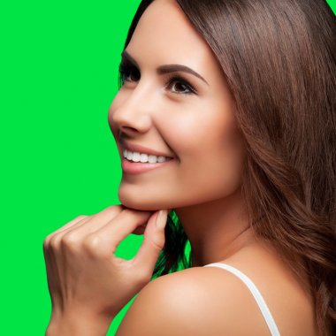 Thinking smiling young beautiful woman, on green chroma key back
