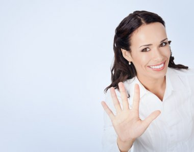 Businesswoman showing five fingers
