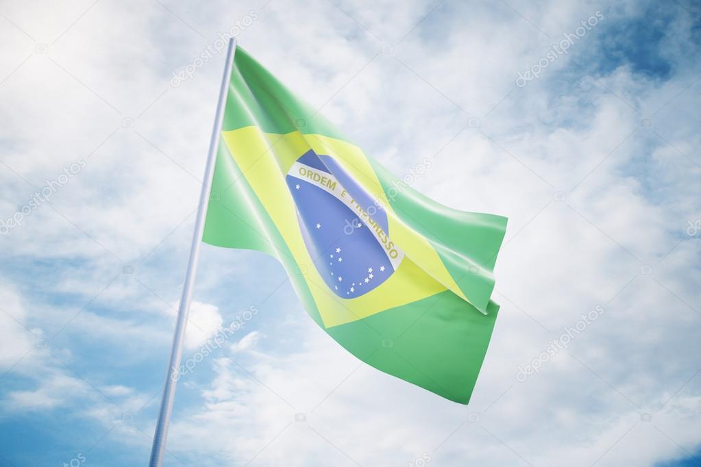 Waving Brazilian flag on a sky background