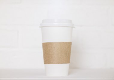 Coffee cup on white brick