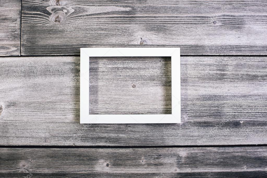 Rectangular see-through frame hanging on wooden wall. Mock up ...
