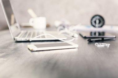 Smartphone on designer desktop