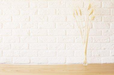 Wheat spikes on wooden desktop