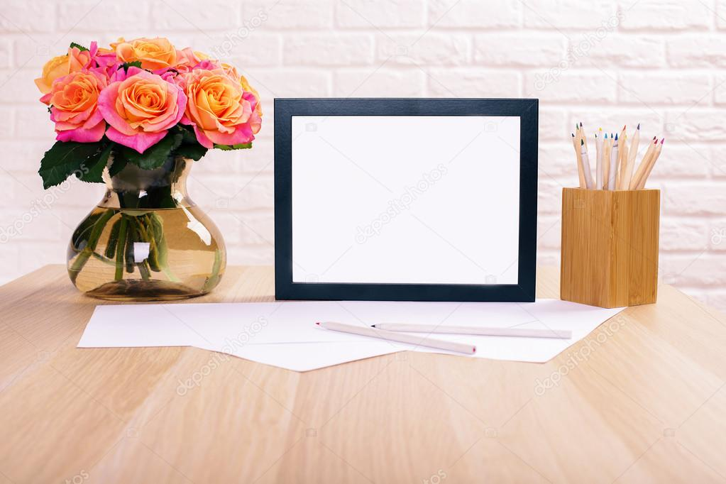 Blank frame, roses and stationery