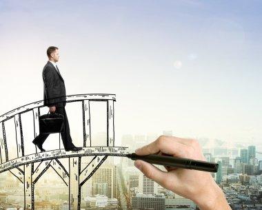 Success concept man on bridge