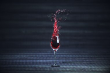 Splashing glass of wine