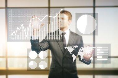 Businessman managing business charts