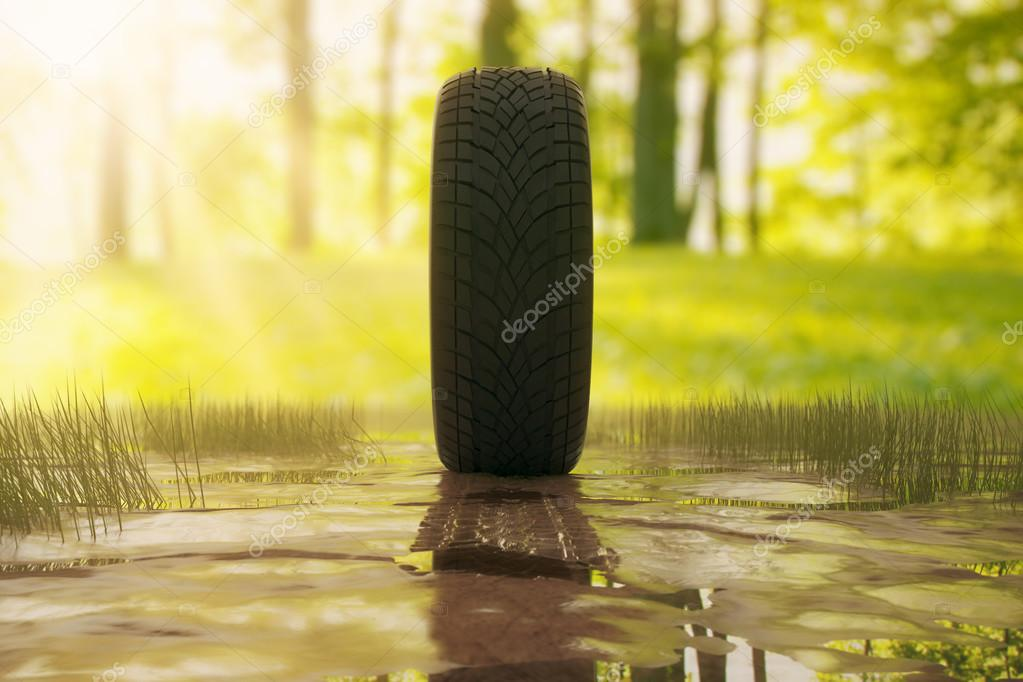 Side view of tire outside in the dirt. Green trees and grass in the background. 3D Rendering