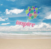 Fotografie Colorful air balloons with text on sea and sky background. Inspiration concept
